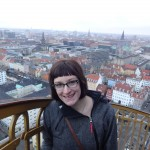 At the top of the giant spiral spire of Vor Frelsers Kirke